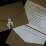 anne marie and James gold and ivory invitation with round rhinestone