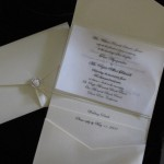 white on white invite with vellum overlay rhinestone on pocketfold and vellum
